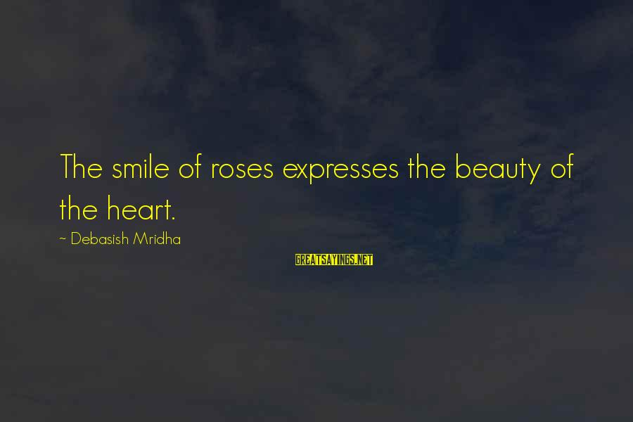 Beauty In Your Smile Sayings By Debasish Mridha: The smile of roses expresses the beauty of the heart.
