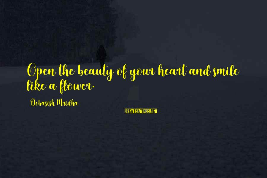 Beauty In Your Smile Sayings By Debasish Mridha: Open the beauty of your heart and smile like a flower.