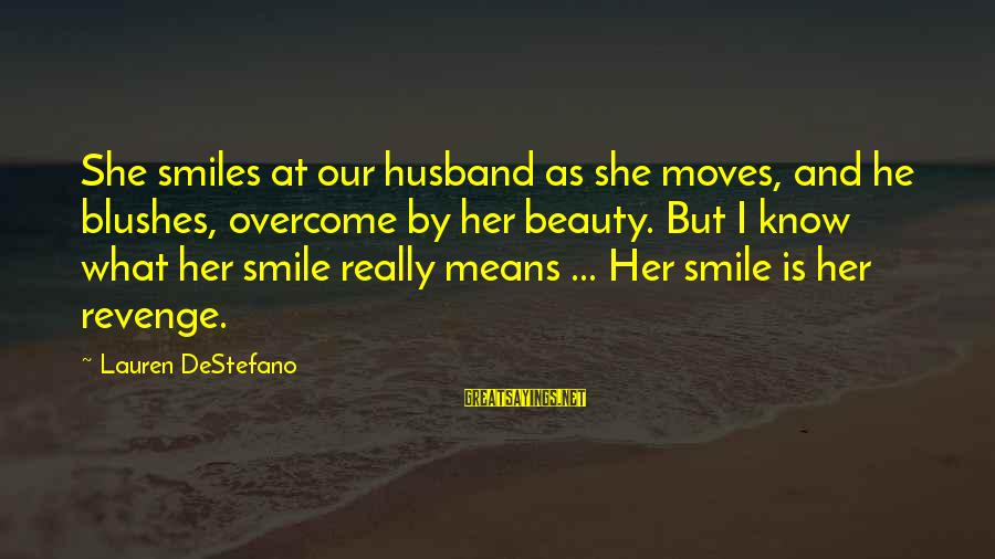 Beauty In Your Smile Sayings By Lauren DeStefano: She smiles at our husband as she moves, and he blushes, overcome by her beauty.