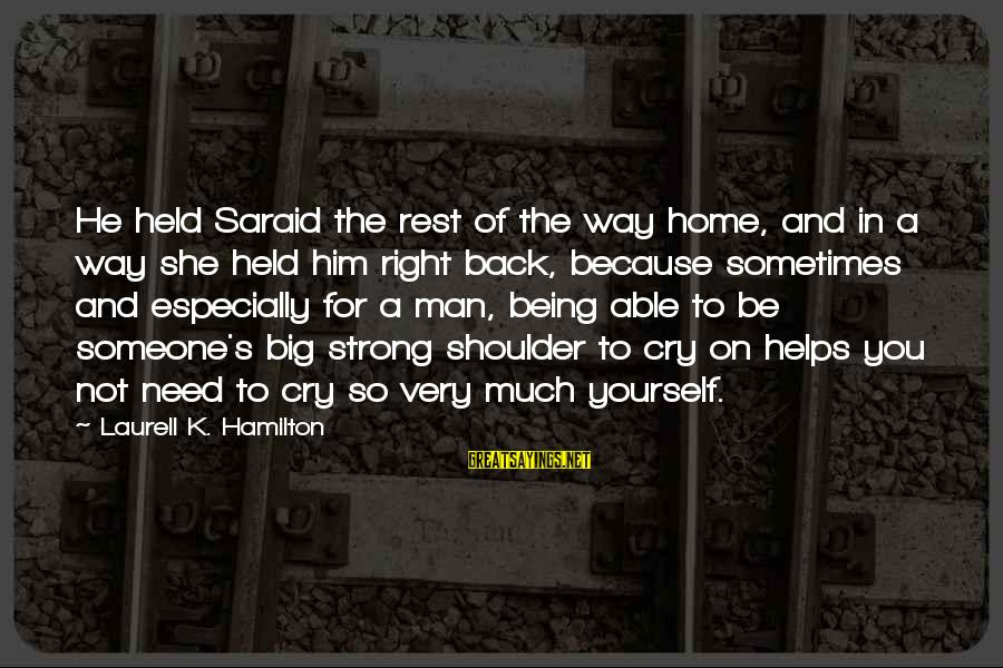 Crying Man Sayings By Laurell K. Hamilton: He held Saraid the rest of the way home, and in a way she held
