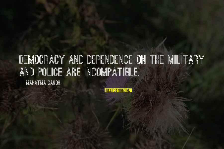 Democracy By Gandhi Sayings By Mahatma Gandhi: Democracy and dependence on the military and police are incompatible.