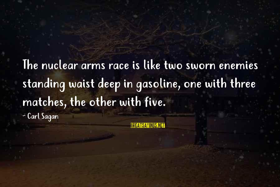Enemies In War Sayings By Carl Sagan: The nuclear arms race is like two sworn enemies standing waist deep in gasoline, one
