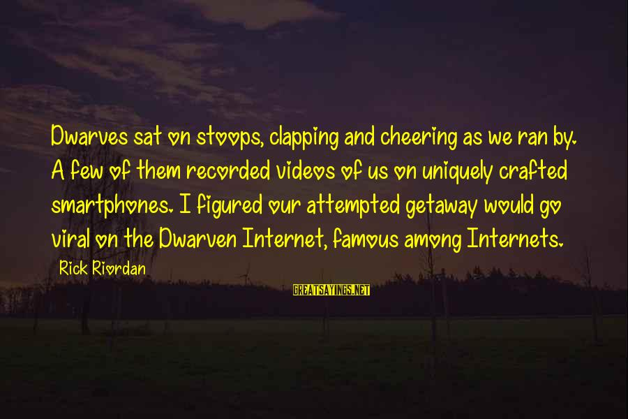 Famous Us Sayings By Rick Riordan: Dwarves sat on stoops, clapping and cheering as we ran by. A few of them
