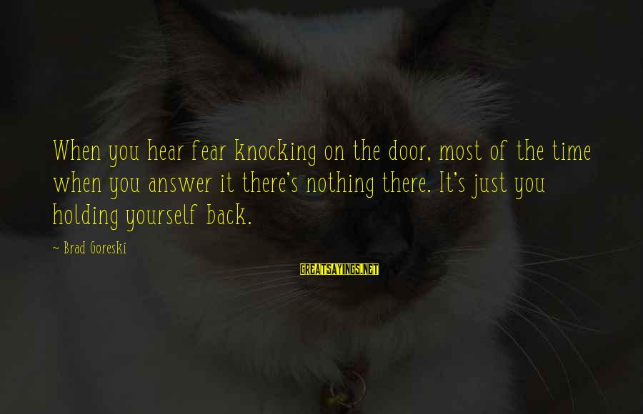 Fear Holding You Back Sayings By Brad Goreski: When you hear fear knocking on the door, most of the time when you answer