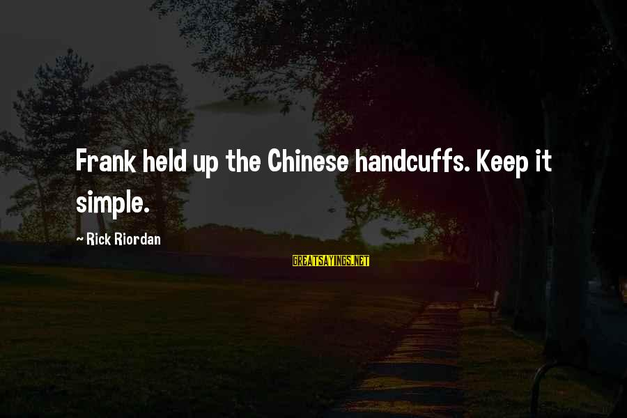 Handcuffs Sayings By Rick Riordan: Frank held up the Chinese handcuffs. Keep it simple.