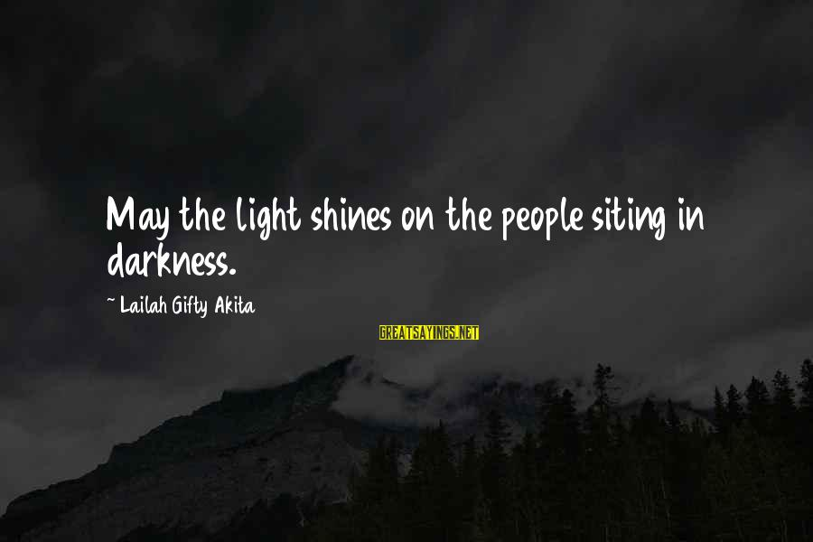 Light Shines In The Darkness Sayings By Lailah Gifty Akita: May the light shines on the people siting in darkness.