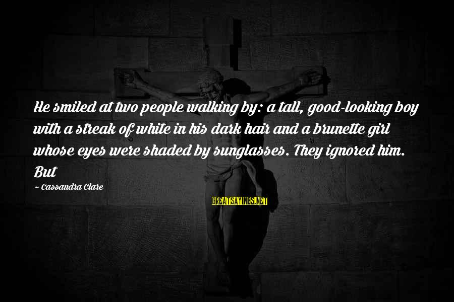 Looking At Him Sayings By Cassandra Clare: He smiled at two people walking by: a tall, good-looking boy with a streak of