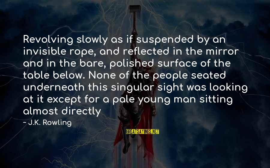 Looking In A Mirror Sayings By J.K. Rowling: Revolving slowly as if suspended by an invisible rope, and reflected in the mirror and