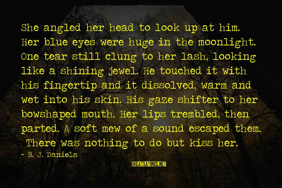Looking Into His Eyes Sayings By B. J. Daniels: She angled her head to look up at him. Her blue eyes were huge in