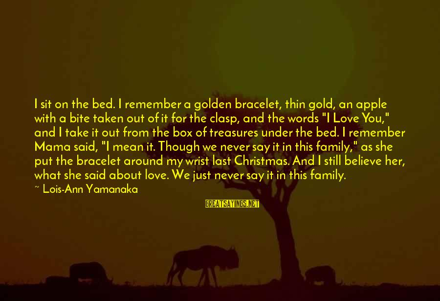 Mean Of Family Sayings By Lois-Ann Yamanaka: I sit on the bed. I remember a golden bracelet, thin gold, an apple with