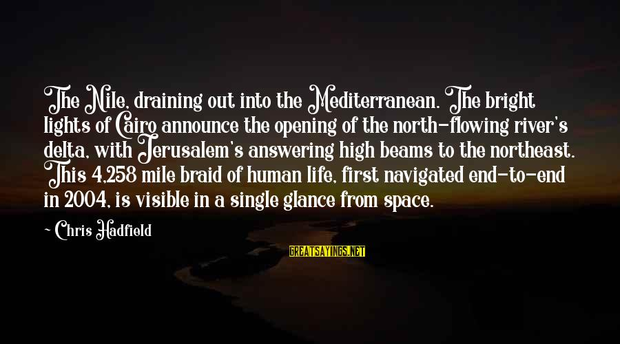 Mediterranean's Sayings By Chris Hadfield: The Nile, draining out into the Mediterranean. The bright lights of Cairo announce the opening