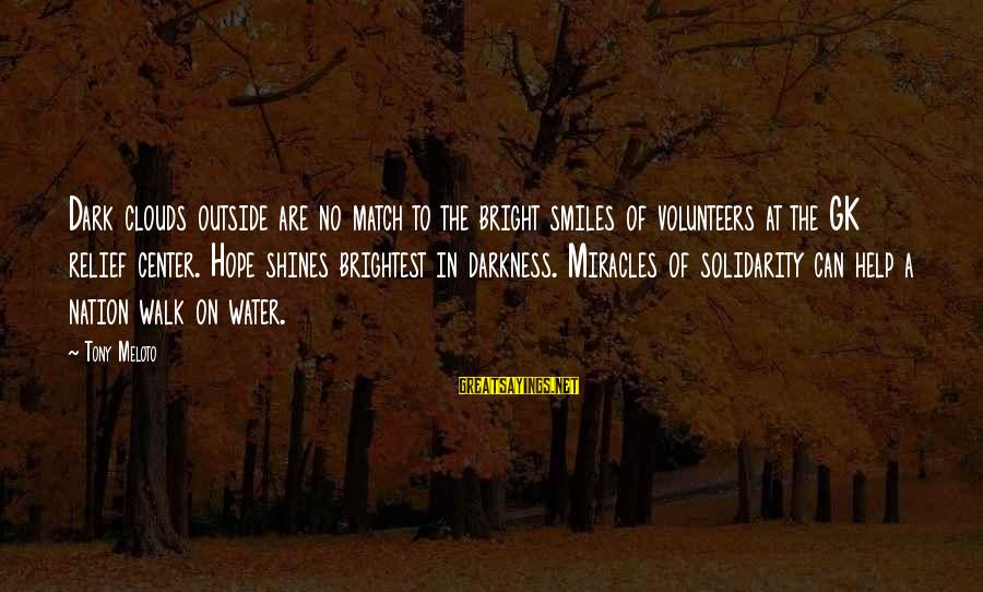 Volunteers Sayings By Tony Meloto: Dark clouds outside are no match to the bright smiles of volunteers at the GK