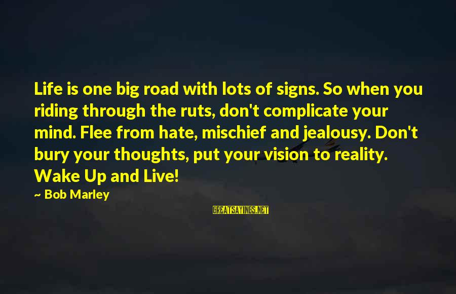 Wake Up To Reality Sayings By Bob Marley: Life is one big road with lots of signs. So when you riding through the